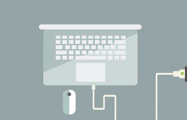 ilustrace notebooku s nabíječkou